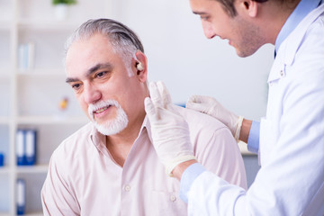 Male patient with hearing problem visiting doctor otorhinolaryng