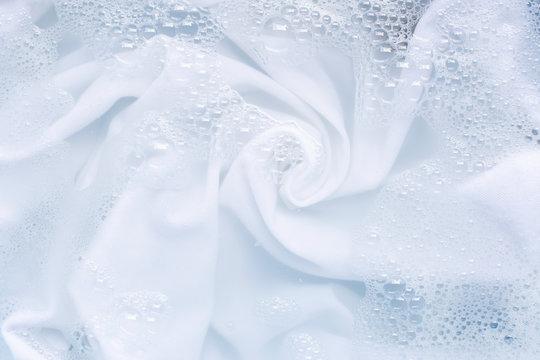Soak a cloth before washing, white cloth.
