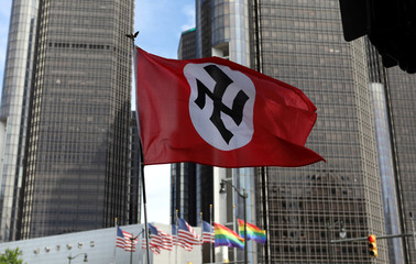 Members of the National Socialist Movement, a white nationalist group, demonstrate against the LGBTQ event Motor City Pride in Detroit, Michigan