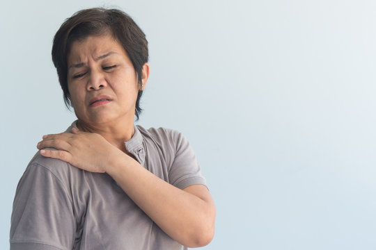 old senior woman suffers from shoulder joint pain or osteoporosis