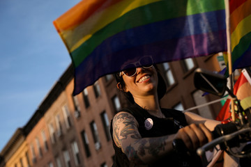 A participant takes part in the Brooklyn Pride Twilight Parade in Brooklyn, New York