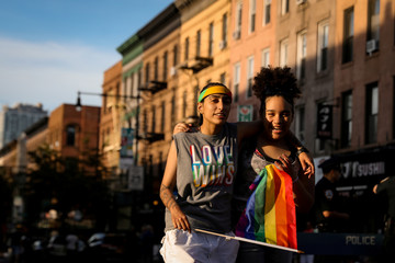 Participants take part in the Brooklyn Pride Twilight Parade in Brooklyn, New York