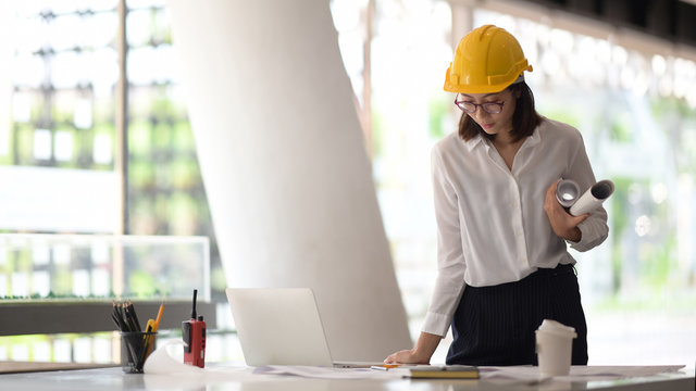 Confident engineer woman in office