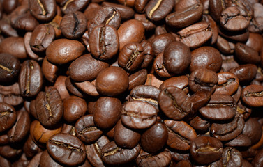 Roasted coffee beans, coffee, aromatic food and drinks. Top view flat texture