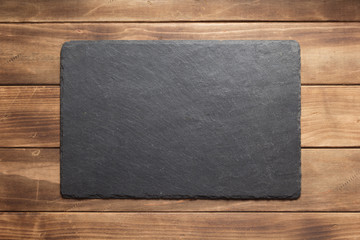 slate stone sign board at wooden plank