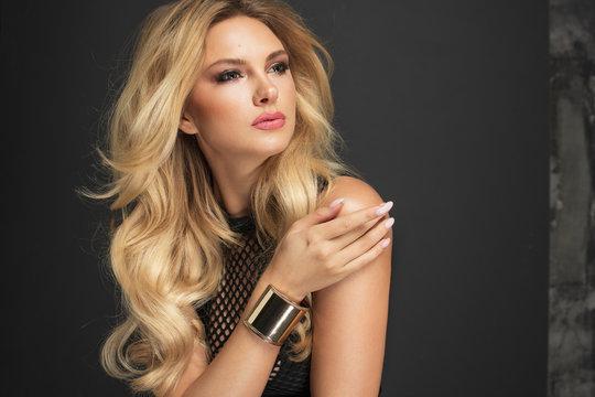 Beauty Model Woman with Long Blonde Wavy Hair.