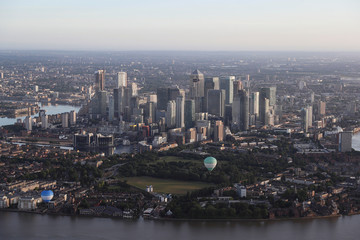 Hot air balloons fly over the Canary Wharf district during the Lord Mayor's Hot Air Balloon Regatta, in London