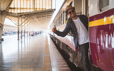 Young traveler man at platform train station. Traveling concept.