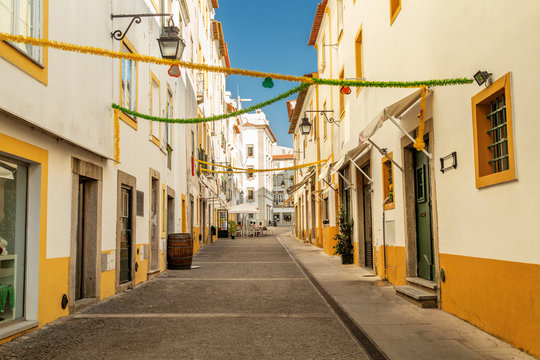 Streets of Evora, Portugal. White and yellow houses on a sunny day