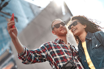 Cheerful young people are taking selfie outdoor