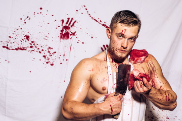 Steak or beefsteak. False imagination of masculinity. Splashing blood. A young man is holding a knife in hands and slices of meat.
