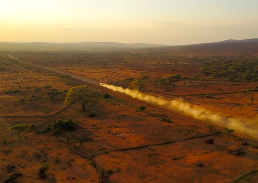 Aerial view of of a truck in a an arid area making a lot of dust, Oromia, Yabelo, Ethiopia