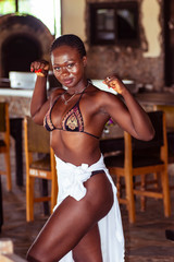 I am a strong African woman. Stand in a restaurant and show their muscles. The picture taken in Axim.
