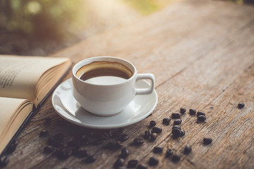 White ceramic coffee cup of black hot americano on wooden table