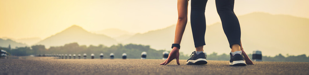 close up of woman leg in running start to reach the goal. Jogging workout and sport healthy...