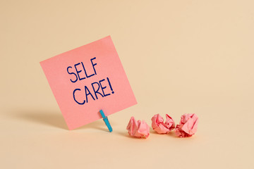Handwriting text Self Care. Conceptual photo practice of taking action preserve or improve ones own health Plain note paper and stationary placed above soft pastel colour backdrop