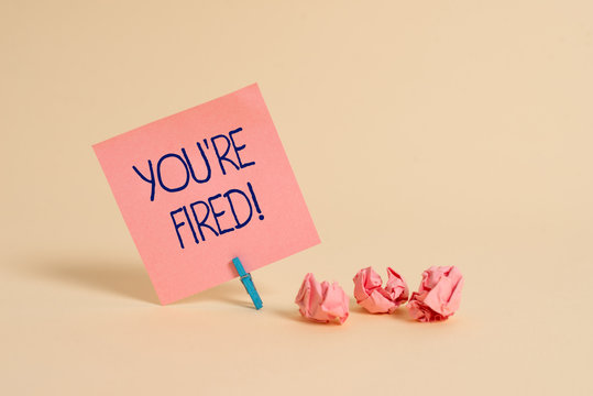 Handwriting text You Re Fired. Conceptual photo Used by boss indicate employee that he is discharged from job Plain note paper and stationary placed above soft pastel colour backdrop