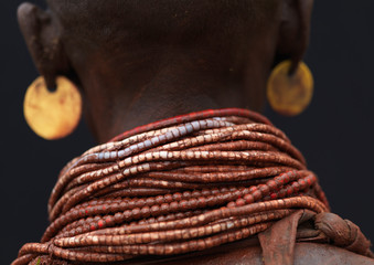 Detail of back view karo woman beaded necklaces ethiopia