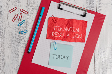 Word writing text Financial Regulation. Business photo showcasing aim to Maintain the integrity of Finance System Clipboard paper sheet crushed sticky note clip marker wooden background