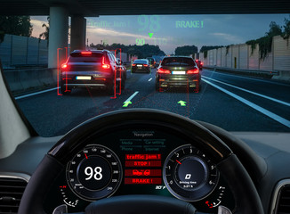 view from the cockpit of a car equipped with HUD and active safety systems.The systems detected a traffic jam on the motorway and activated emergency braking Fototapete