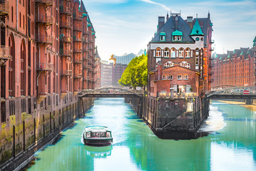 Hamburg Speicherstadt harbor district with tour boat in summer, Germany