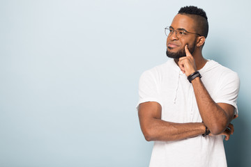 Happy black male looking on copy space, advertising banner.