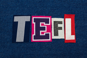 TEFL text word collage, multi colored fabric on blue denim, teach english as a foreign language acronym, horizontal aspect
