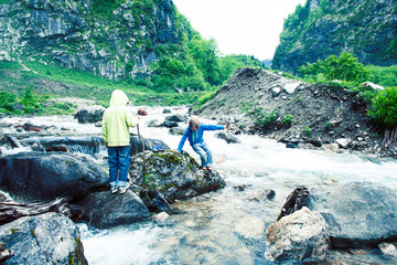 little cute boy playing in mountain river, lifestyle people on summer vacation concept