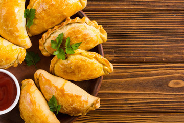 Latin American baked beef empanadas with sauce