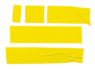 Set of  different yellow sticky tapes. Torn crumpled sellotape pieces isolated on white background