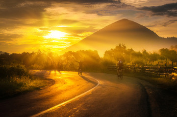 Road biking at sunrise healthy activity beautiful landscape