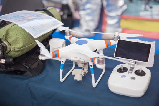 Drone with remote control. Professional quadcopter for making aerial photo at emergency services show