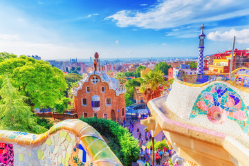 Barcelona, Spain, famous landmark Park Guell. Colorful summer scene of eye-popping architecture. Popular travel destination in Spain, Europe. UNESCO world heritage list spot.