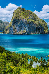 Breathtaking view of tropical coast with jungle and Pinagbuyutan Island in the blue ocean El Nido, Palawan, Philippines. Must see, most unique beautiful natural scenery