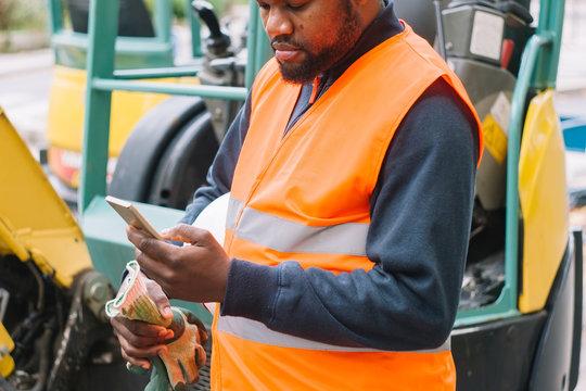Construction worker taking a phone break