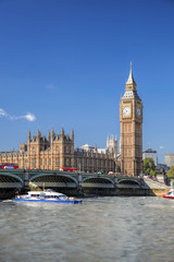 Foto auf Leinwand London roten bus Big Ben and Houses of Parliament with red buses against boat in London, England, UK