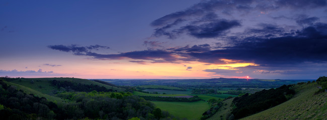 Summer sunset over Meon Valley towards Beacon Hill and Old Winchester Hill, South Downs National Park Wall mural