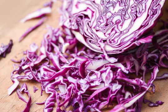 Cabbage purple - Shredded red cabbage slice in a wooden cutting board