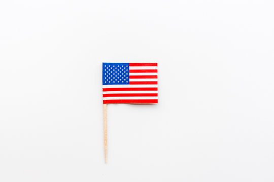 Happy Independence Day 4th july with mini USA flag lying on white background. Top view. Mock up, overhead, flatlay. Memorial Day.
