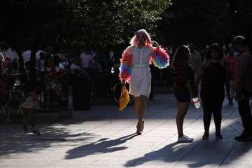 """A participant dressed in drag walks before to start the """"Drag Queen Story Hour"""" event, which according to organizers involves participants reading stories to children for an hour, in downtown Monterrey"""