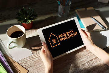 Property investment. Business and finance concept on device screen.