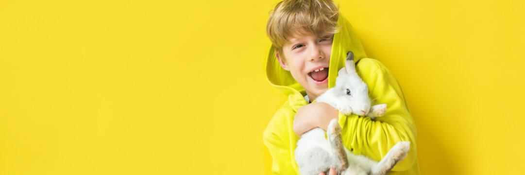 Concept yellow on yellow wall. Happy little boy