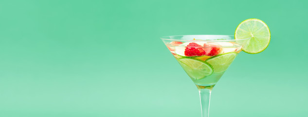 Mixed summer chilled lemonade drink in green pastel banner background
