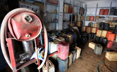 Empty gasoline containers are seen in a store in Ben Guerdane, near the Libyan border in Tunisia