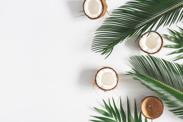 Foto auf AluDibond Palms Summer composition. Coconut, palm leaf on pastel gray background. Summer concept. Flat lay, top view, copy space