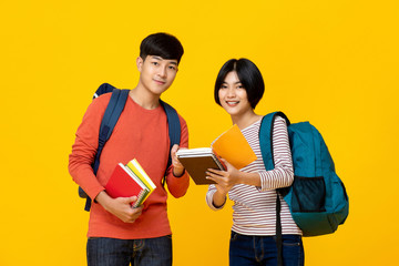 Smiling Asian college student friends with backpacks holding books Wall mural
