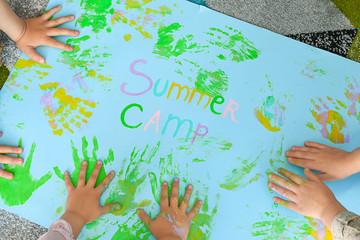 Little children during art lesson in summer camp