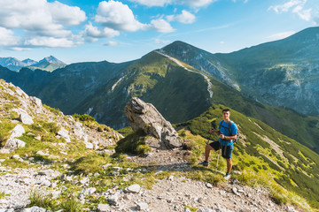 sporty man hiker on top of mountain, Tatry