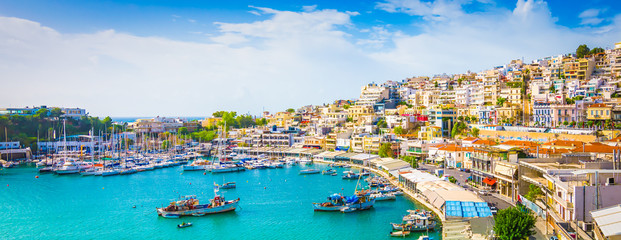 Zelfklevend Fotobehang Athene Panoramic view of Mikrolimano with colorful houses along the marina in Piraeus, Greece.