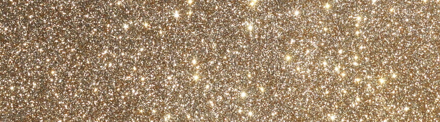 blur glitter or bokeh gold festive background,  texture banner, panoramic. Xmas abstract background with copy space.
